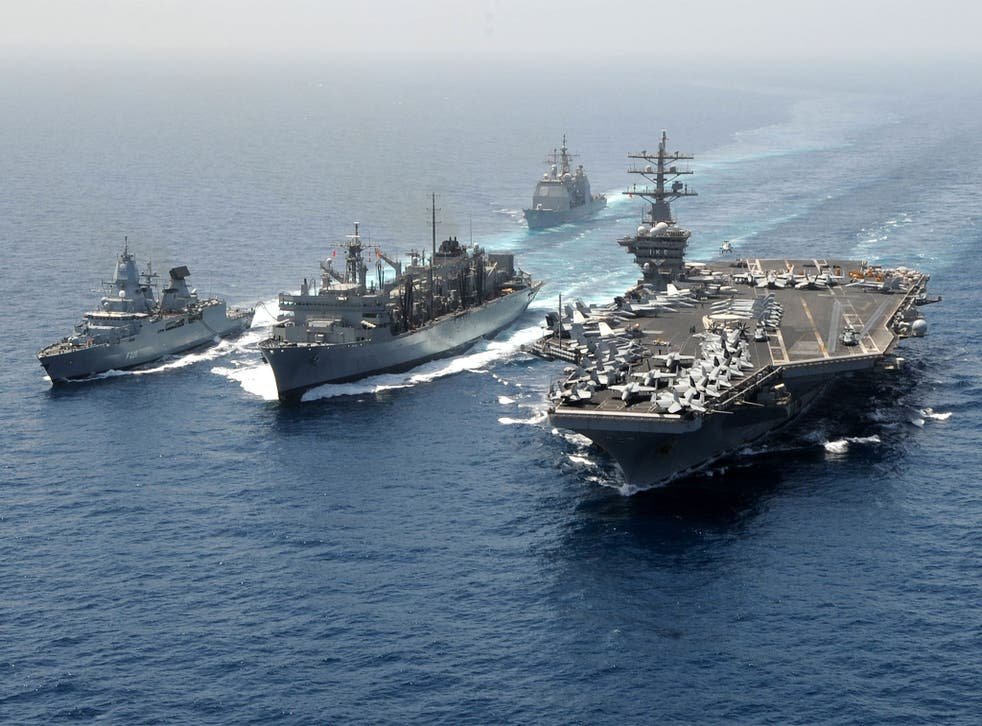 The former flagship of Standing Nato Maritime Group 2, FGS Hamburg (far left), refuelling from from USNS Bridge with USS Dwight D Eisenhower on the right