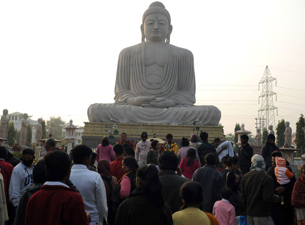 Religious revolutionary: devotees visit the 'Great Statue of Lord Buddha' in Bodhgaya, 2010