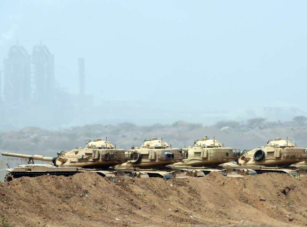 Saudi army tanks are seen deployed near the Saudi-Yemeni border, in southwestern Saudi Arabia, on 9 April, 2015