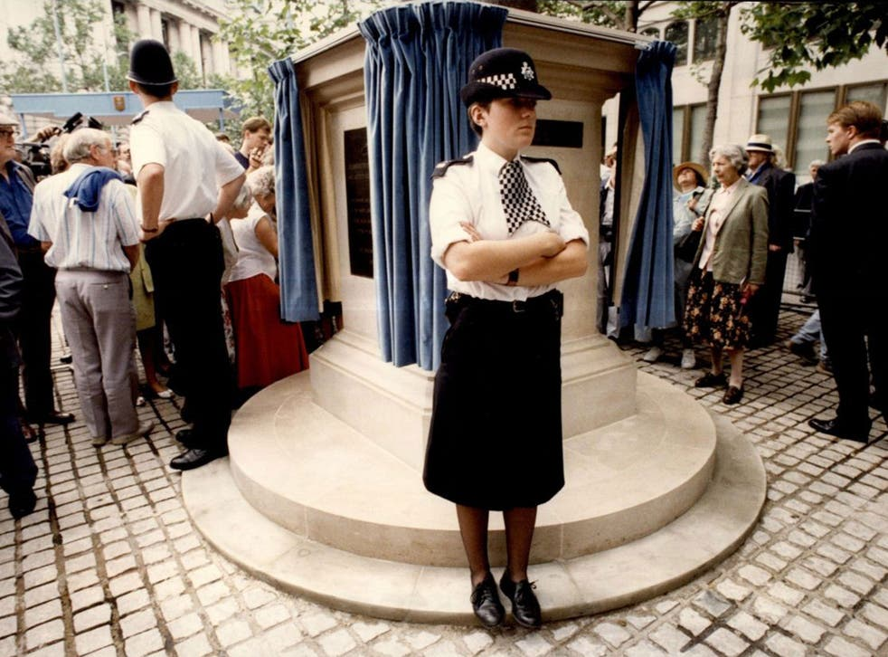 Don't move: police stand guard round 'Bomber' Harris in 1992