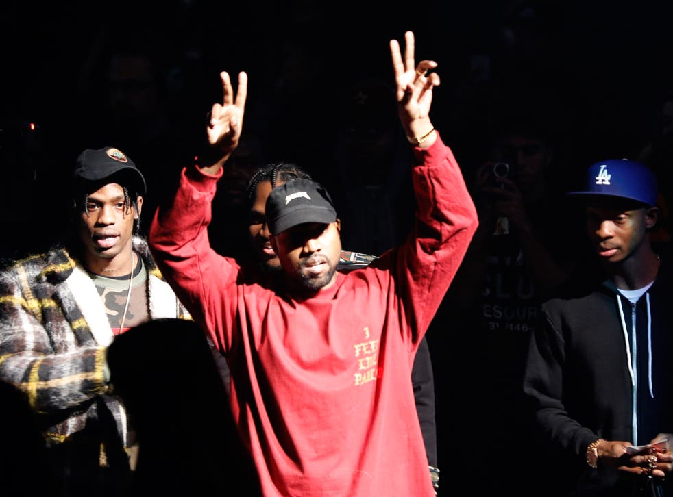 """Kanye West gestures to the audience at the unveiling of the Yeezy collection and album release for his latest album, """"The Life of Pablo,"""" Thursday at Madison Square Garden in New York"""