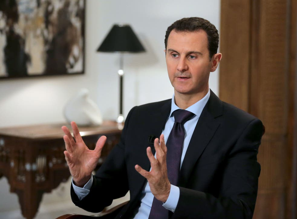 Syrian President Bashar al-Assad during an interview with AFP in the capital Damascus