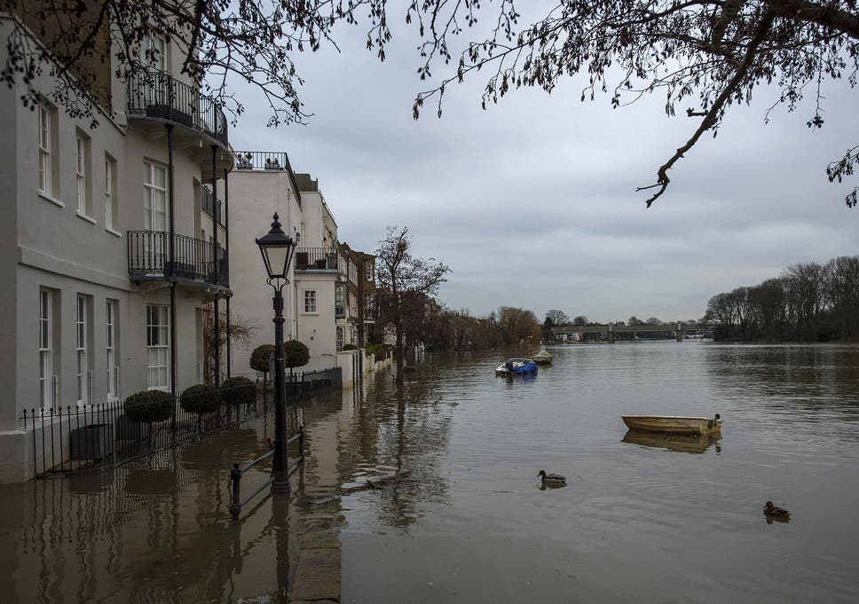UK weather: London flood alerts issued after Thames bursts its banks