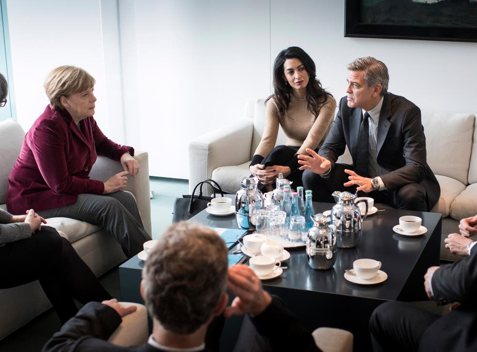 Angela Merkel meets with Amal and George Clooney at the Federal Chancellery to talk about refugee policy