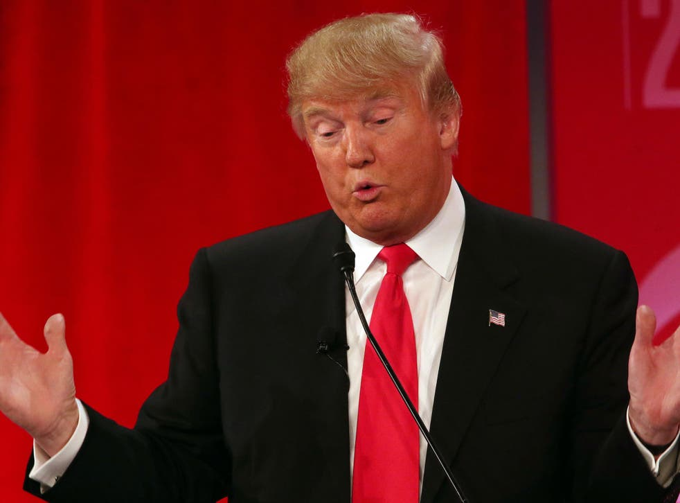 Republican presidential candidate, businessman Donald Trump speaks during the CBS News Republican presidential debate at the Peace Center