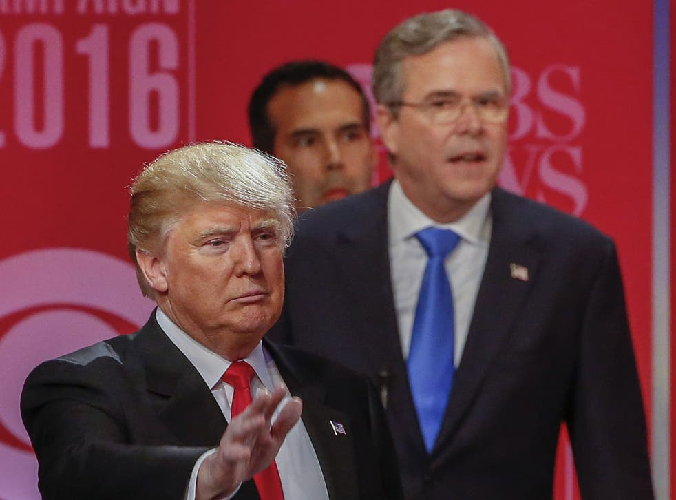 Donald Trump, left, and fellow candidate Jeb Bush speaking at the debate