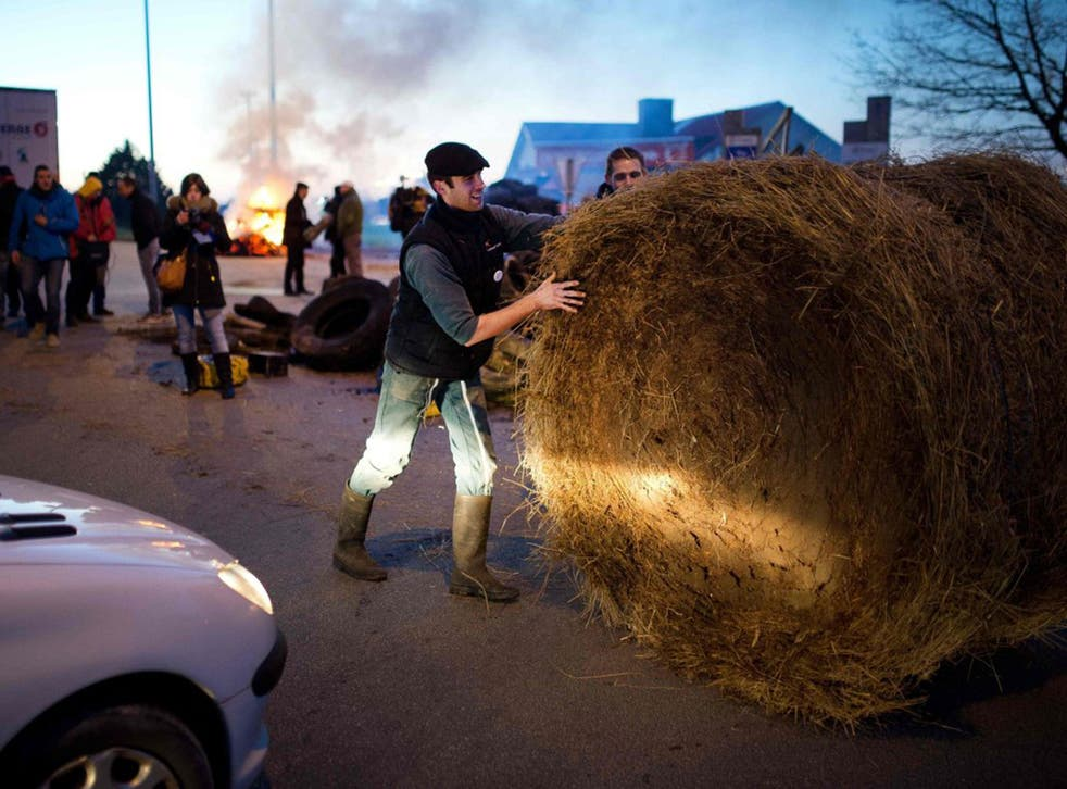 A farmer attempts to block access to Vannes on Monday