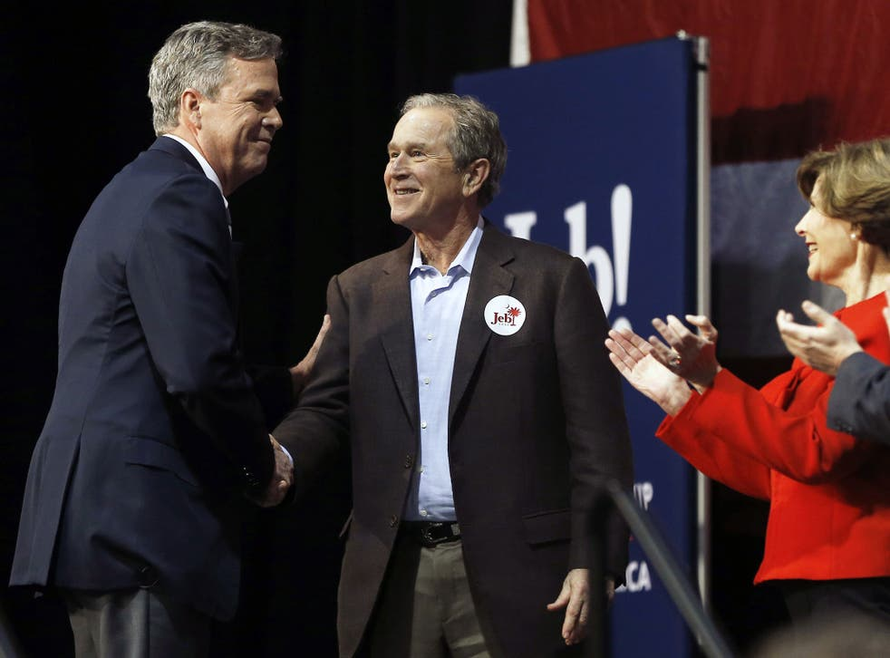 Republican presidential candidate and former Florida Gov. Jeb Bush, left, shakes hands with his brother former President George W. Bush