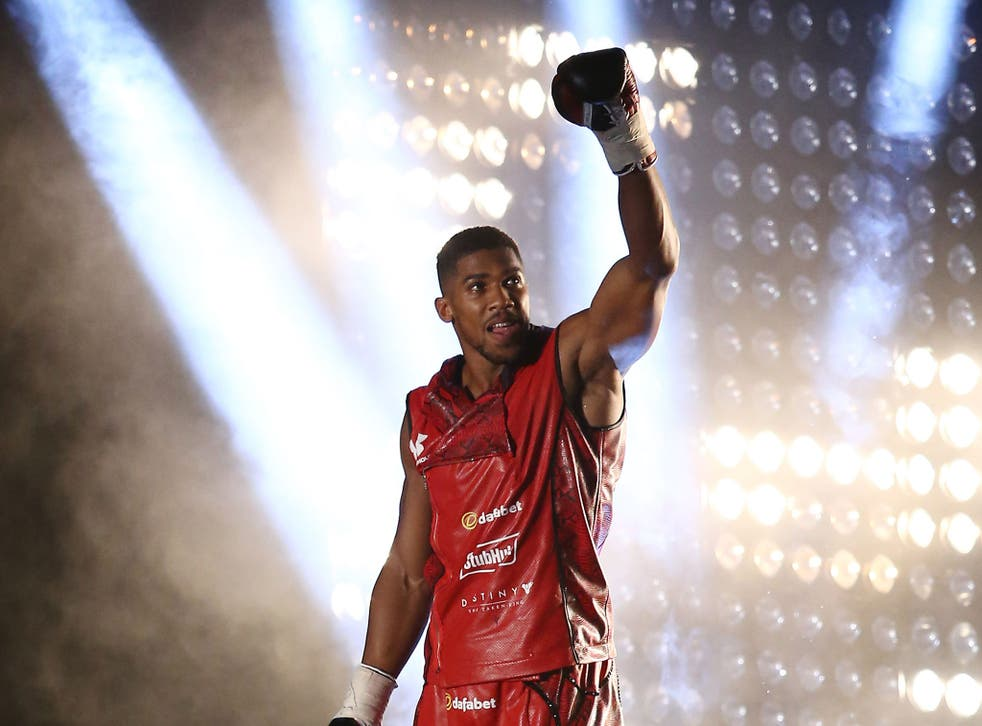 Anthony Joshua walks to the ring before his fight against Dillian Whyte