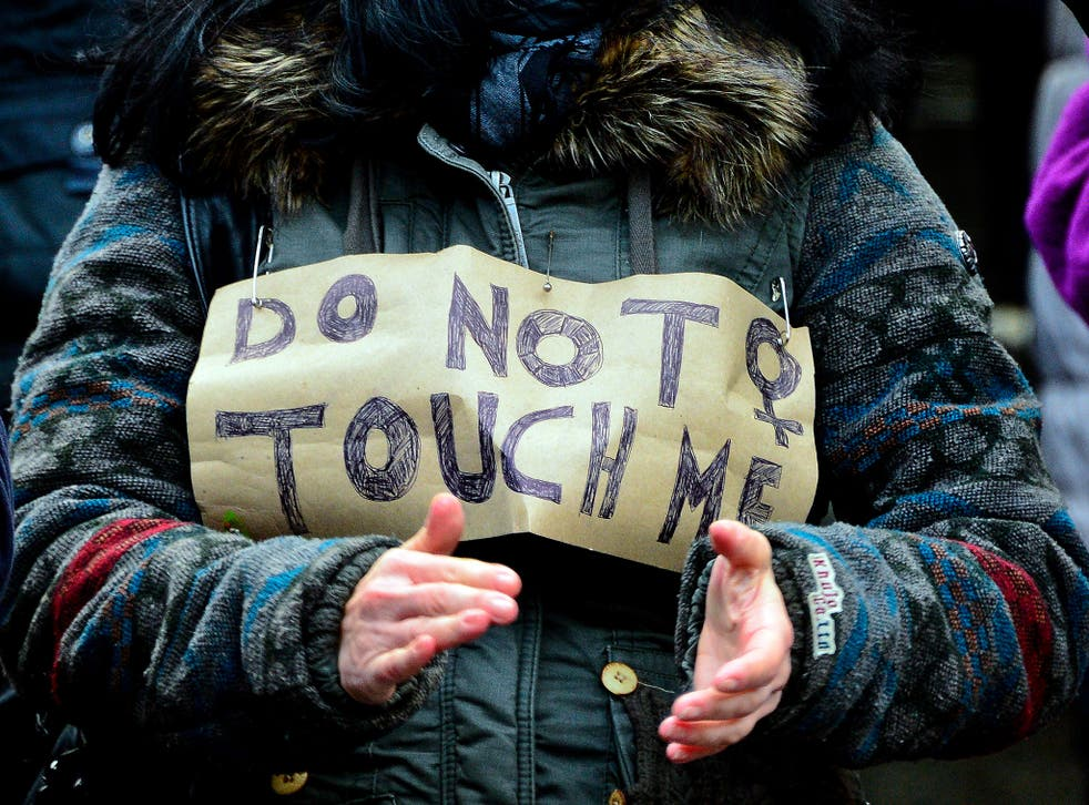 A woman protests in front of Hauptbahnhof main railway station against the New Year's Eve sex attacks on 9 January, 2016, in Cologne, Germany