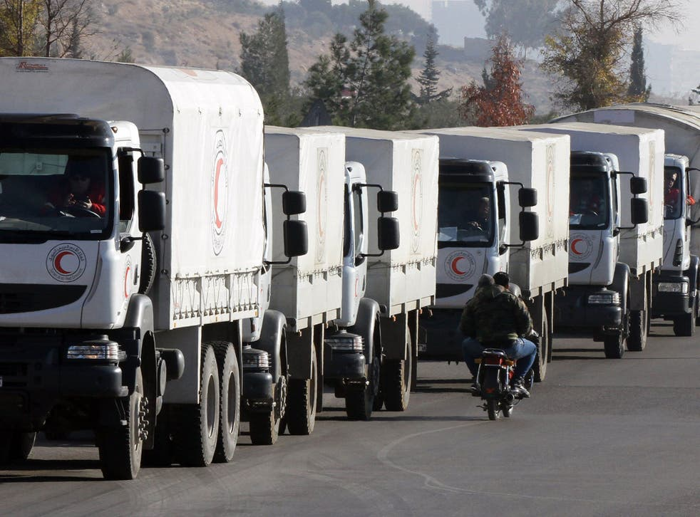 A convoy of aid from the Syrian Arab Red Crescent leaves the capital Damascus for the besieged rebel-held Syrian town of Madaya, on 14 January, 2016