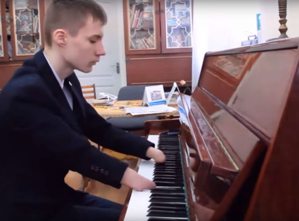 Alexey Romanov, 15,only started reading music three weeks ago