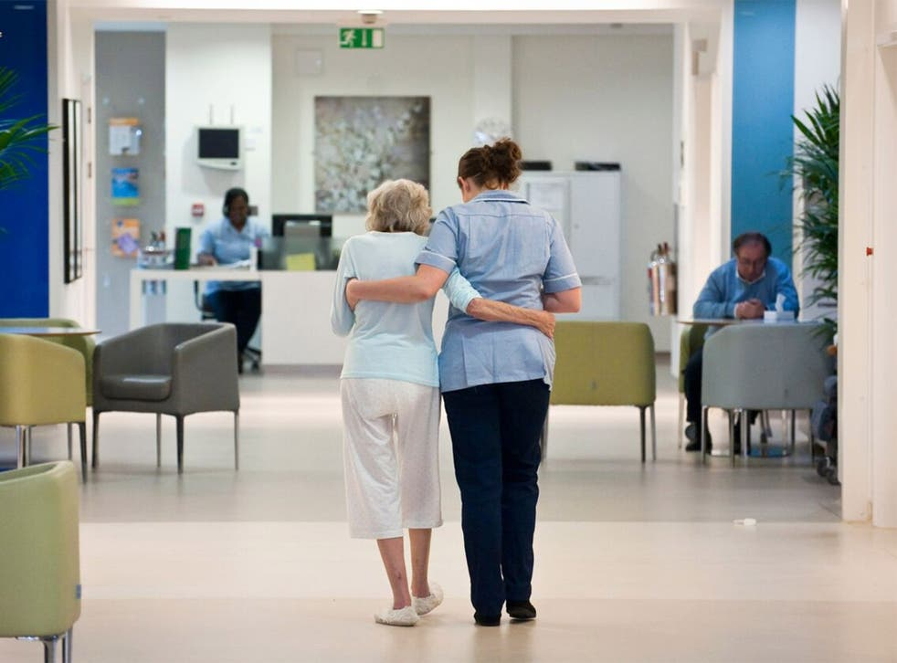 Care values: a patient and nurse at Royal Trinity Hospice