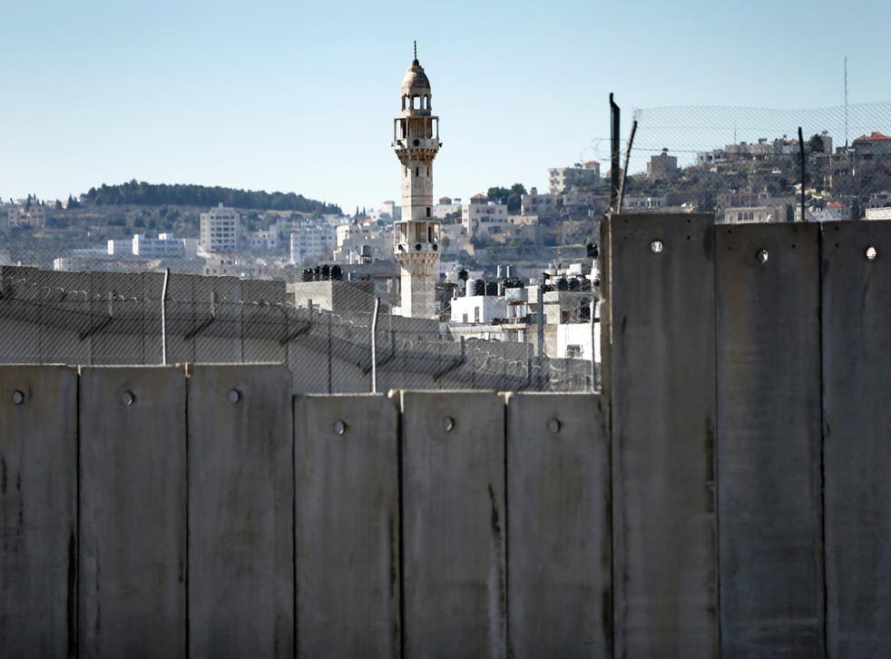 Israel's controversial separation barrier dividing Jerusalem and the West Bank town of Bethlehem, on February 12, 2016