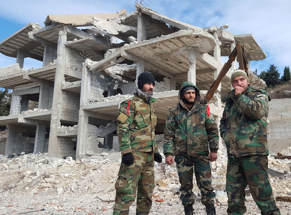Pro-government Syrian forces in al-Rabiaa who have recently taken the town from rebels