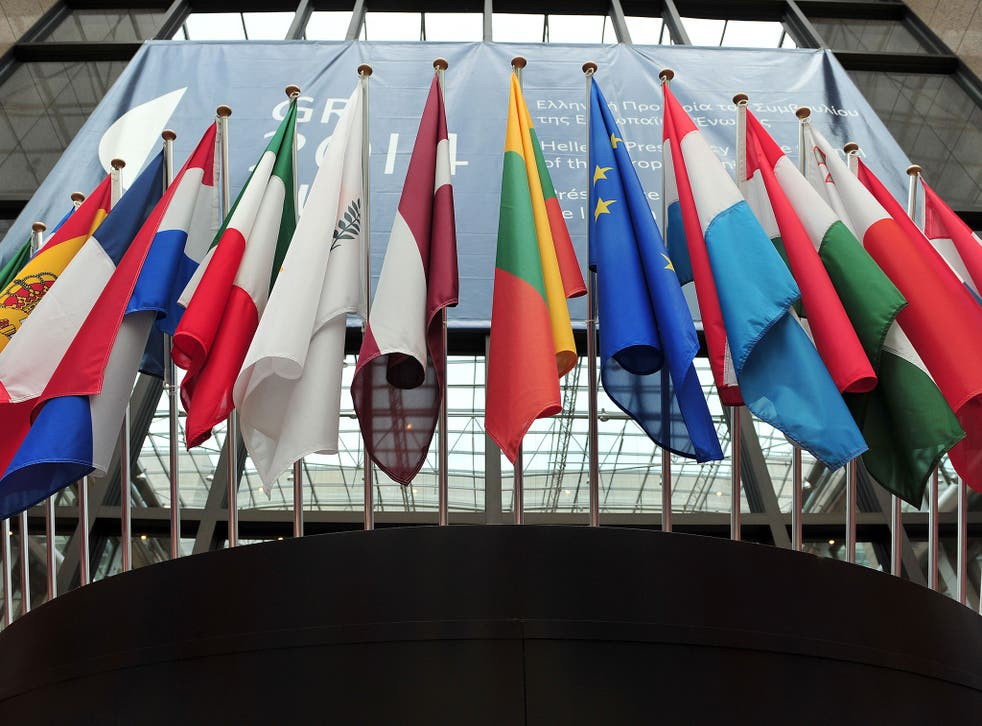 Flags of European countries above the entrance of the European Council