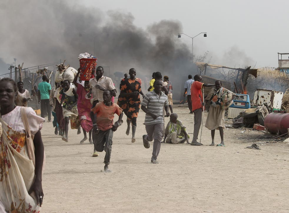 Refugees flee from clashes between ethnic groups in the Malakal refugee camp in South Sudan