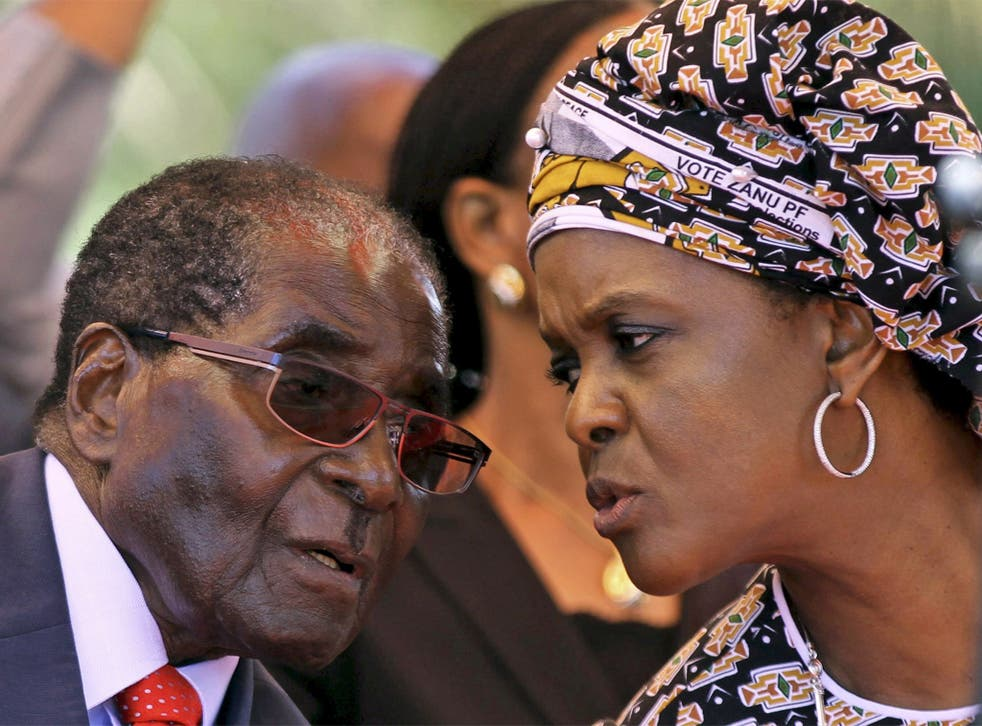 Mr Mugabe before an address to the Politbuo this month in Harare, with his wife Grace