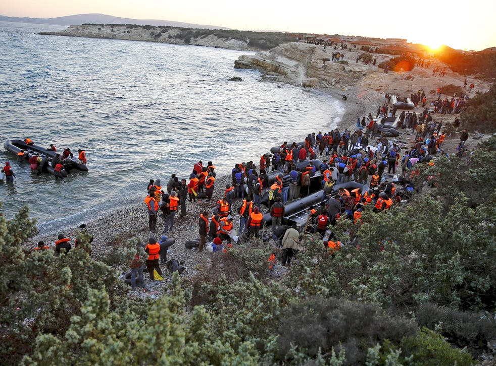 Refugees gather at a beach to try to sail off for the Greek island of Chios from the western Turkish coastal town of Cesme