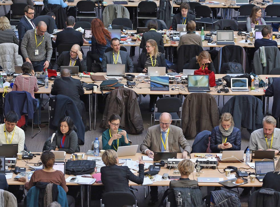 Journalists follow the negotiations as the EU summit entered its second day