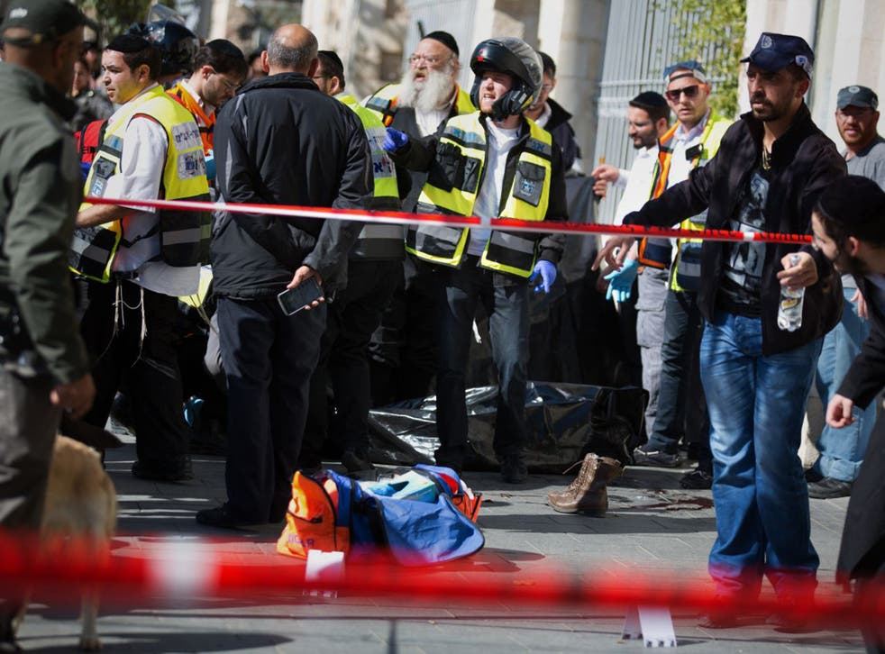 Security forces surround the body of a Palestinian girl who was shot dead while brandishing scissors in Jerusalem