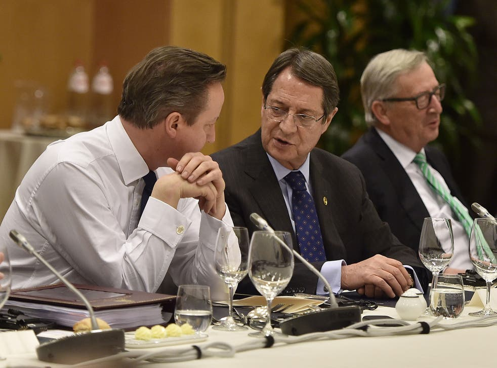 David Cameron discusses details with Cypriot President Nicos Anastasiades and European Commission President Jean-Claude Juncker