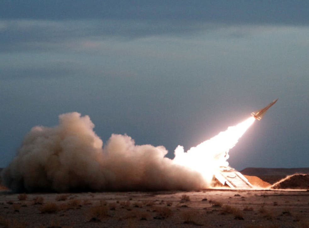 A Hawk surface-to-air missile is launched during military maneuvers at an undisclosed location in Iran on November 13, 2012.