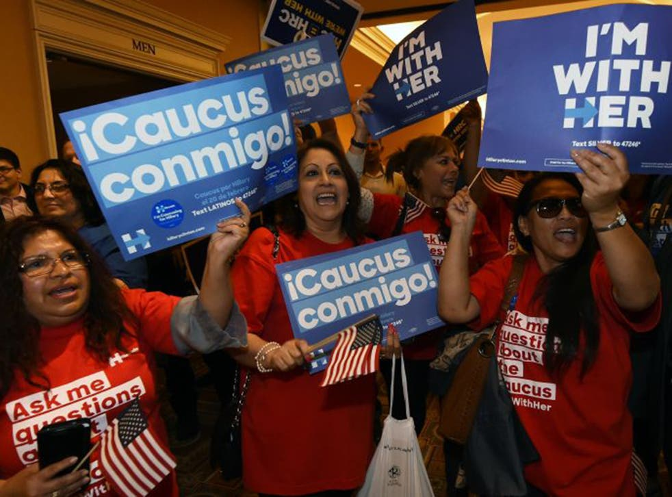 Hillary Clinton supporters celebrate their candidate's narrow victory in the Nevada vote