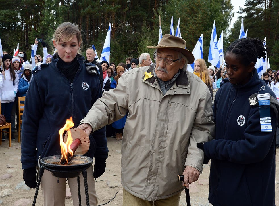 Samuel Willenberg lights a candle in front of the monument of Treblinka Nazi death camp in 2013