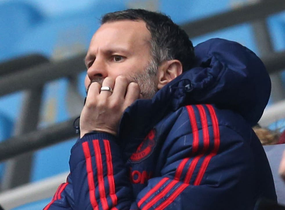 Ryan Giggs looks on from the stand