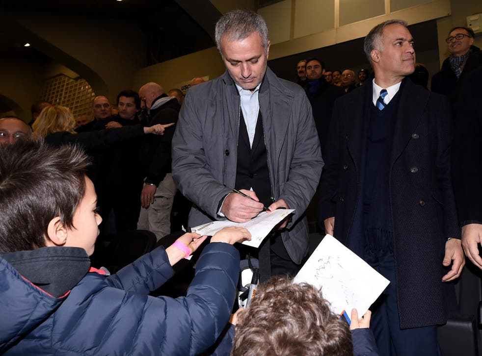 Jose Mourinho signs autographs for Inter Milan supporters while visiting his former club