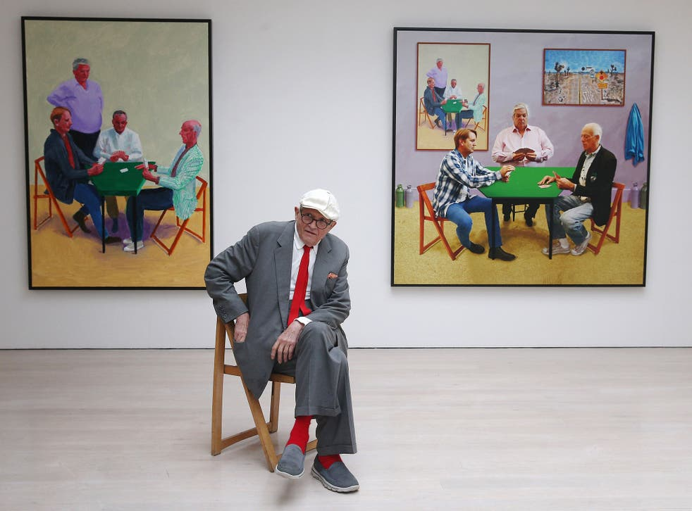 David Hockney with 'Card Player #3', left, and 'Bigger Card Players' at an exhibition in 2015