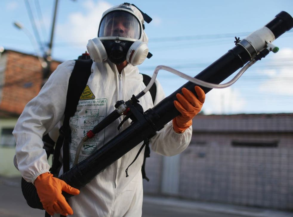 A health worker fumigates in an attempt to eradicate the mosquito which transmits the Zika virus in Recife, Pernambuco state, Brazil.