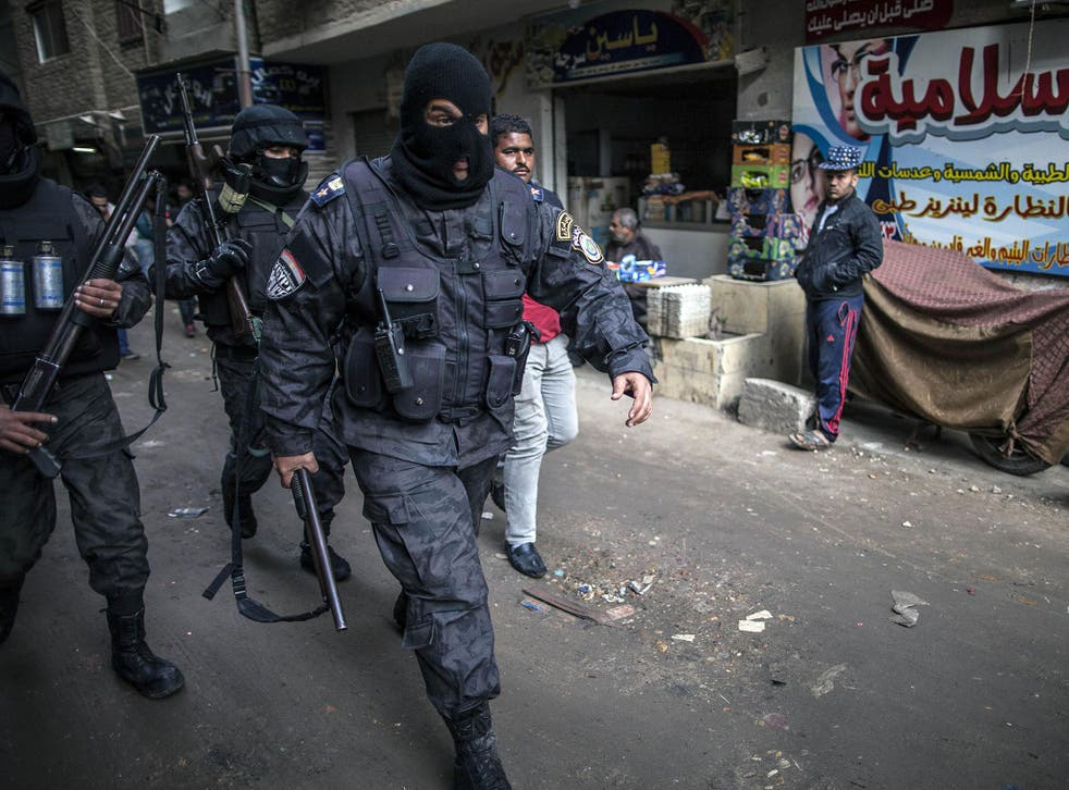Egyptian police patrol al-Haram neighbourhood to head off potential protests against President Abdel Fattah al-Sisi's government
