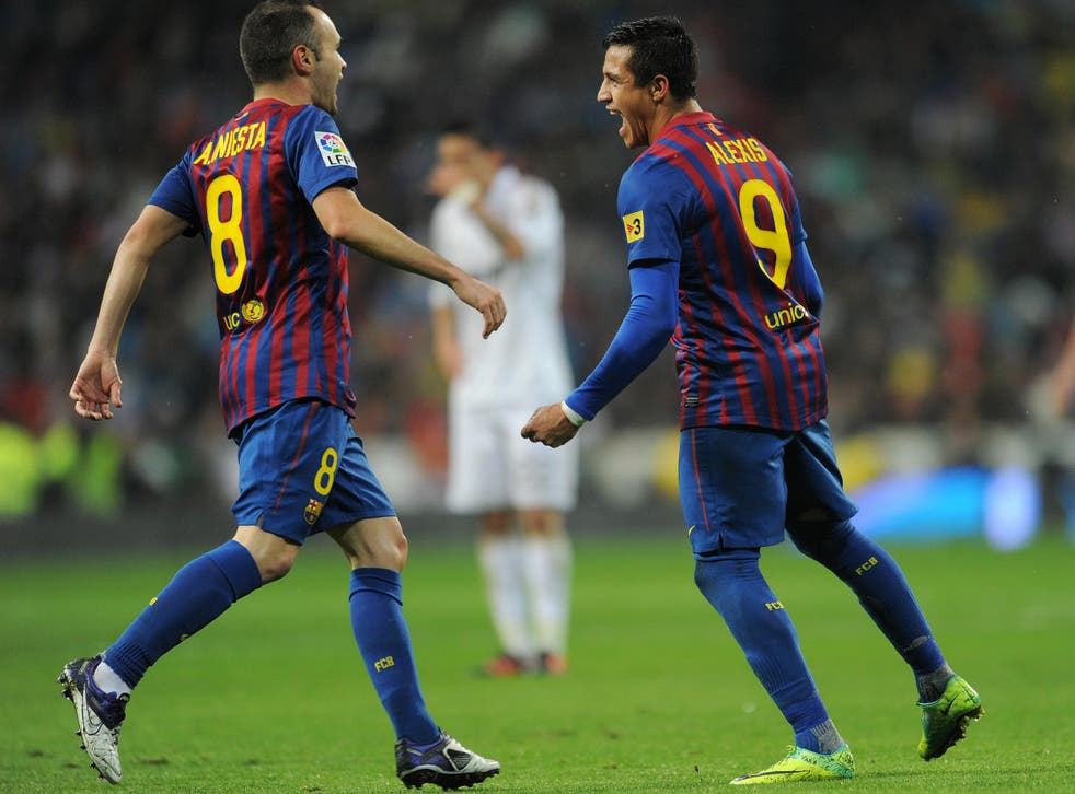 Andres Iniesta and Alexis Sanchez during their time together at Barcelona