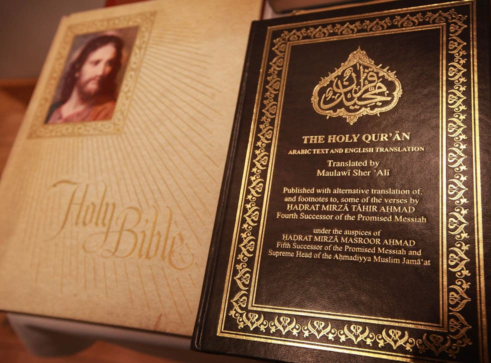 A copy of the Quran is displayed with a bible in the library of the Baitul Futuh Mosque in Morden on September 10, 2010 south of London, England.