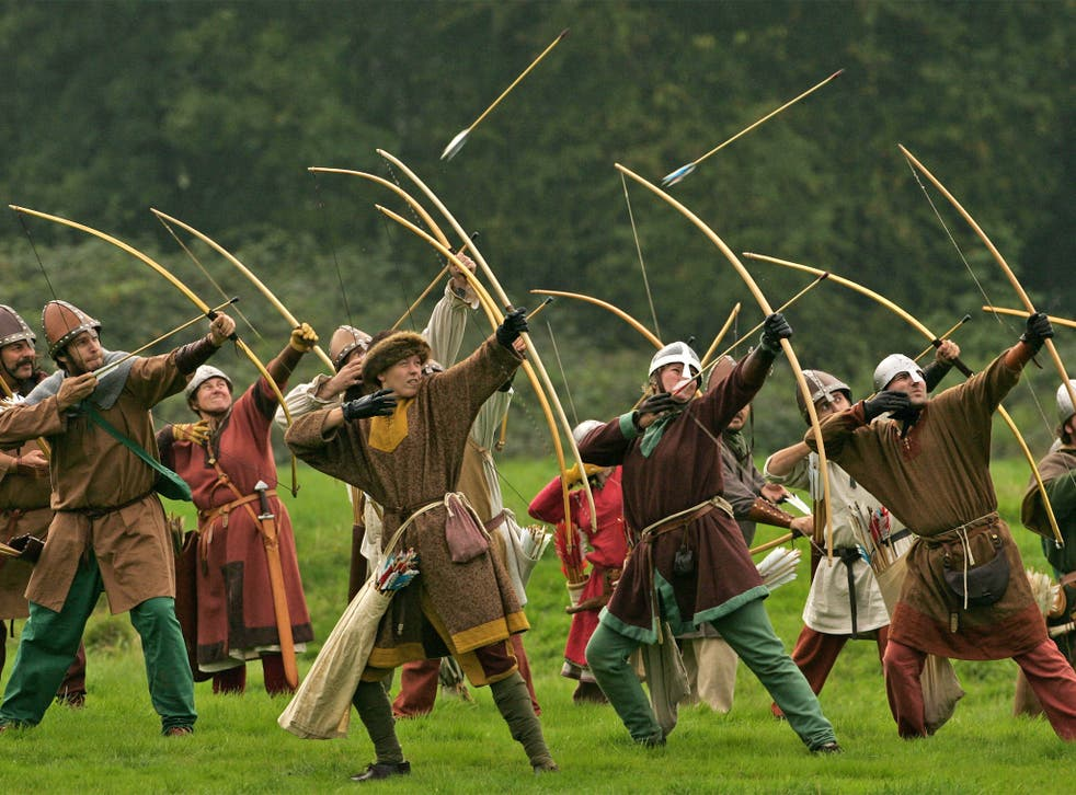 Participants dressed as Norman archers take part in a re-enactment of the 1066 Battle of Hastings