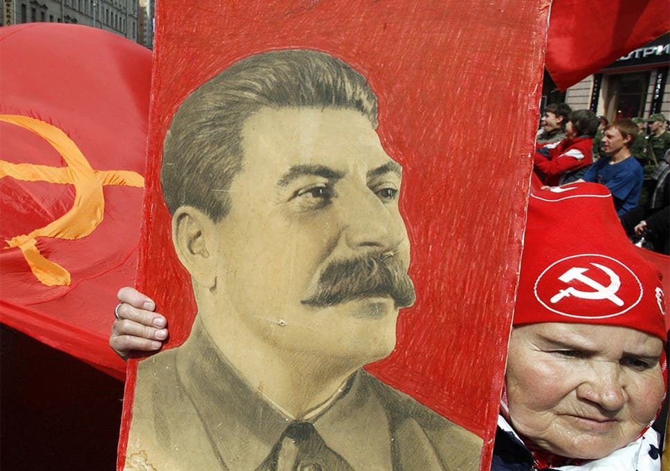 A Russian woman carries a portrait of Soviet leader Josef Stalin in a Victory Day celebration in Moscow