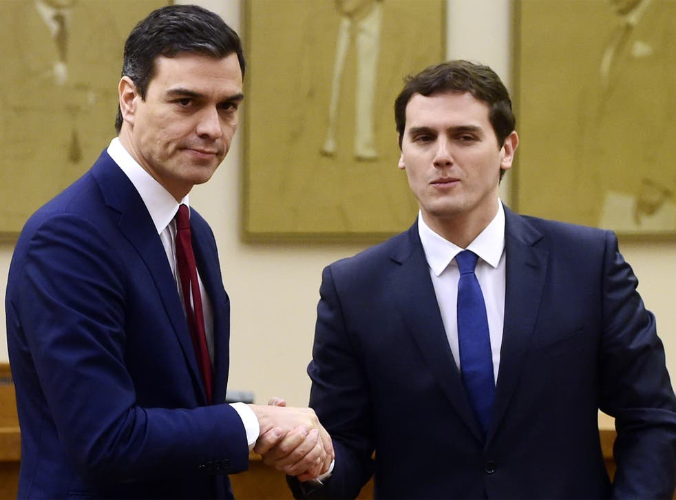 Socialist leader Pedro Sanchez and leader of centre-right party Ciudadanos, Albert Rivera, shake hands after signing an agreement to support Mr Sanchez as candidate to lead the new Spanish government