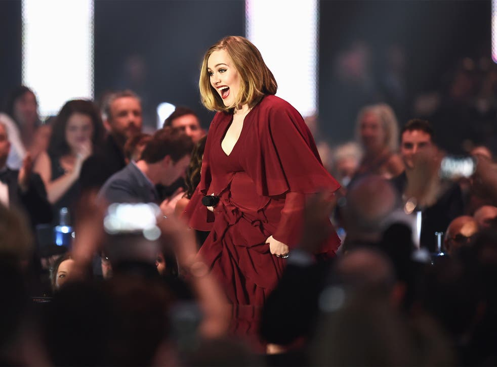 Adele makes her way to the stage to collect one of her four awards