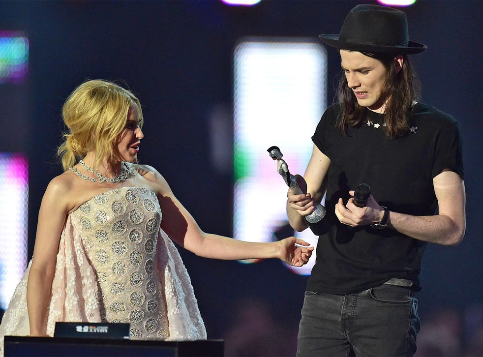 James Bay receives his Best British Male Solo Artist award from Kylie Minogue