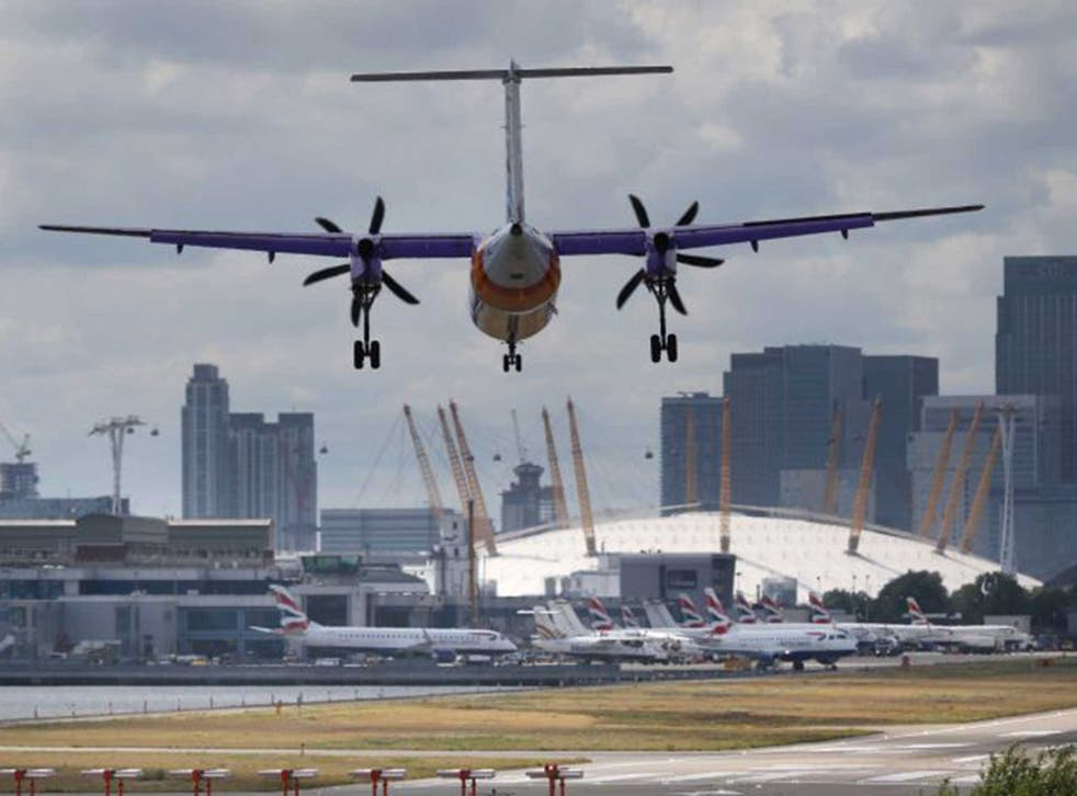 A plane flies in to London City Airport