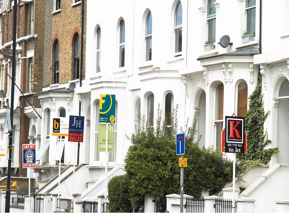 Estate agent signs. House prices in central London are falling, but the commuter belt is becoming more expensive thanks to Crossrail