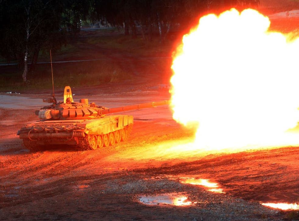 A Russian T-90 tank fires during the 'Army-2015' international military forum in Kubinka, outside Moscow.