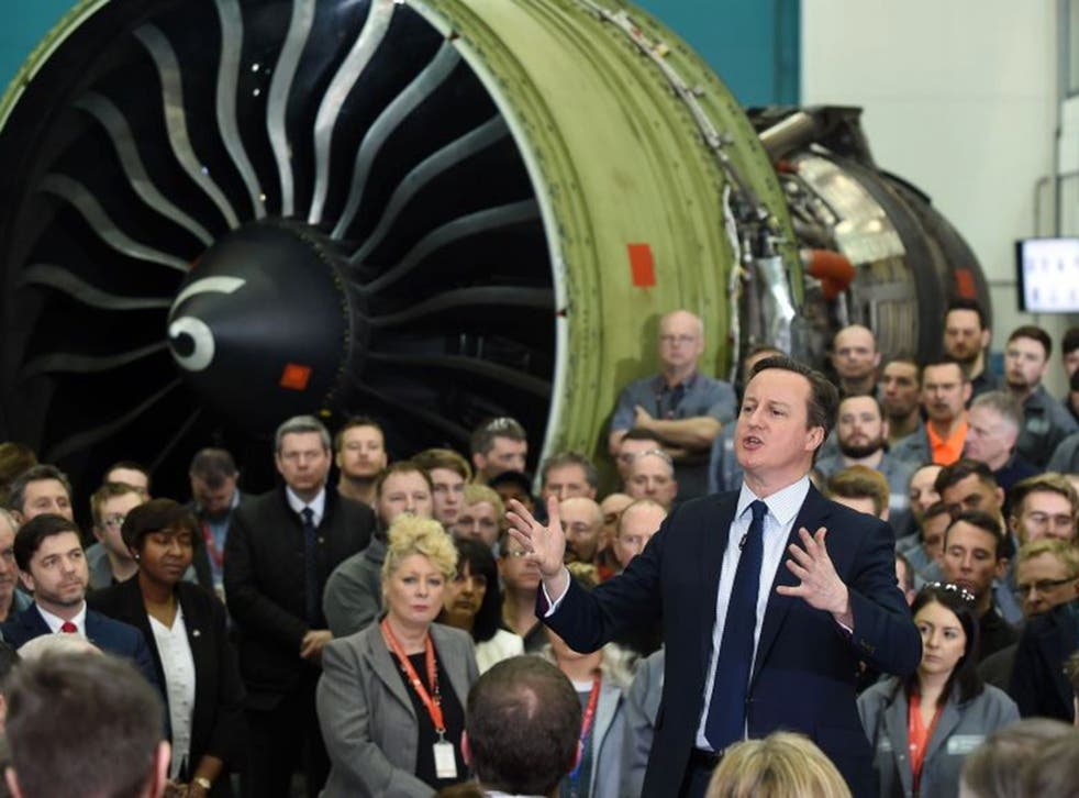 David Cameron speaks to employees during a question and answer session at GE Aviation in Cardiff yesterday