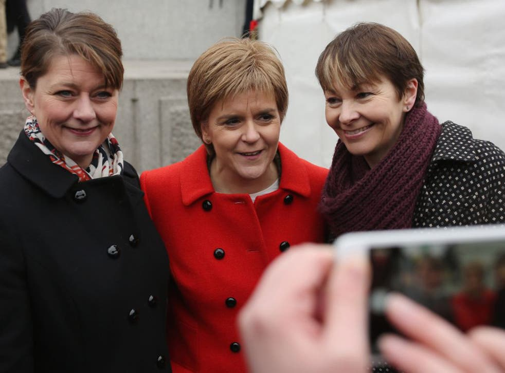 Nicola Sturgeon of the SNP flanked by Leanne Wood of Plaid Cymru, left, and Caroline Lucas of the Green Party