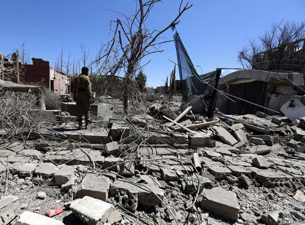 A Yemeni inspects the damage following a Saudi-led airstrike targeting a neighborhood in Sana'a, Yemen, 27 February 2016.