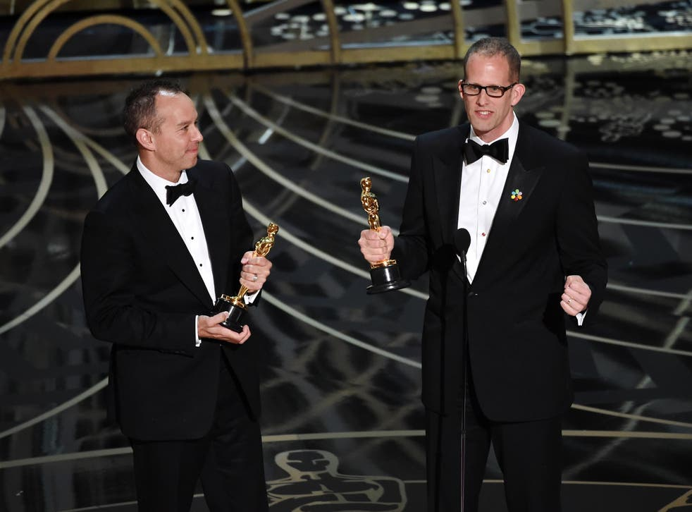 Producer Jonas Rivera (L) and director Pete Docter accept the Best Animated Feature Film award for 'Inside Out'