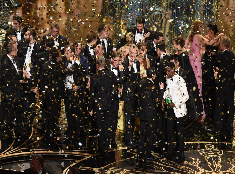 The Spotlight cast and crew celebrate their win