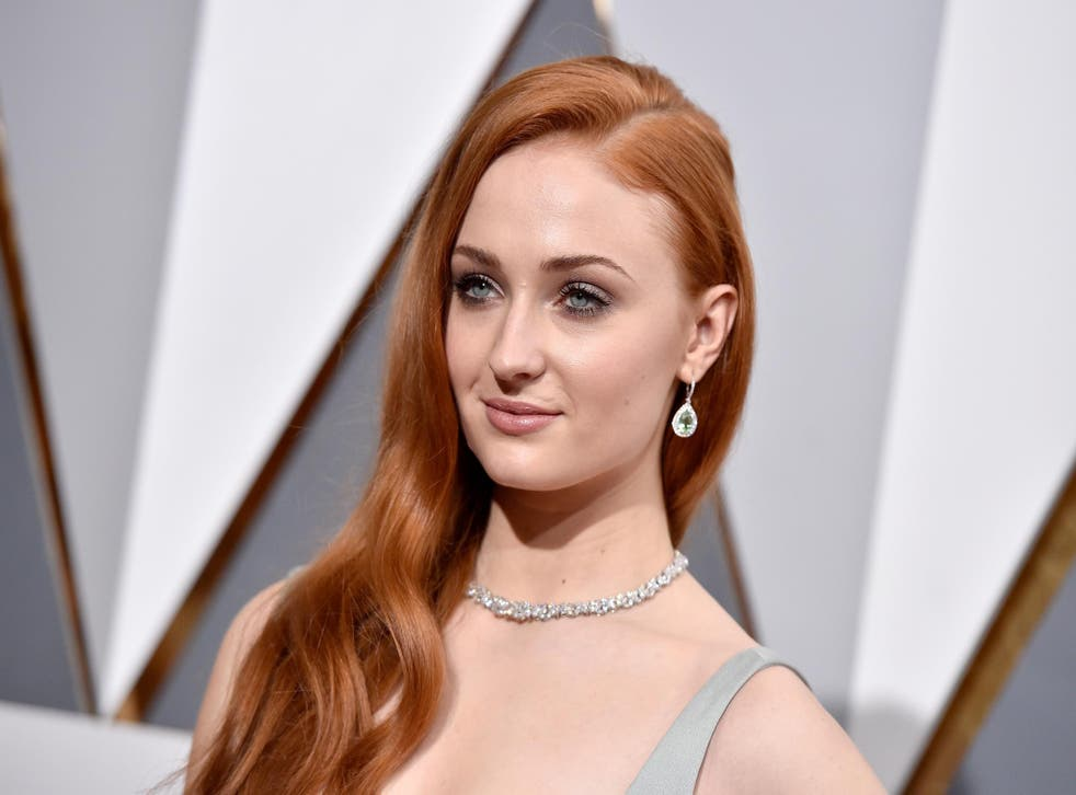 Sophie Turner walking the red carpet at the 88th Academy Awards
